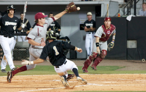 UCF second baseman Travis Shreve scores his first of two runs on the night, as the Knights beat Boston College 6-5.