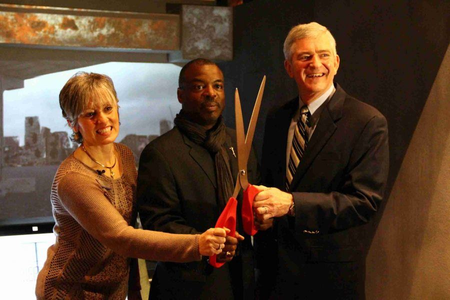 "JoAnn Newman, President & CEO for Orlando Science Center, along with actor LeVar Burton and Congressman Daniel Webster at the ribbon cutting for ""Corrosion: The Silent Menace."""
