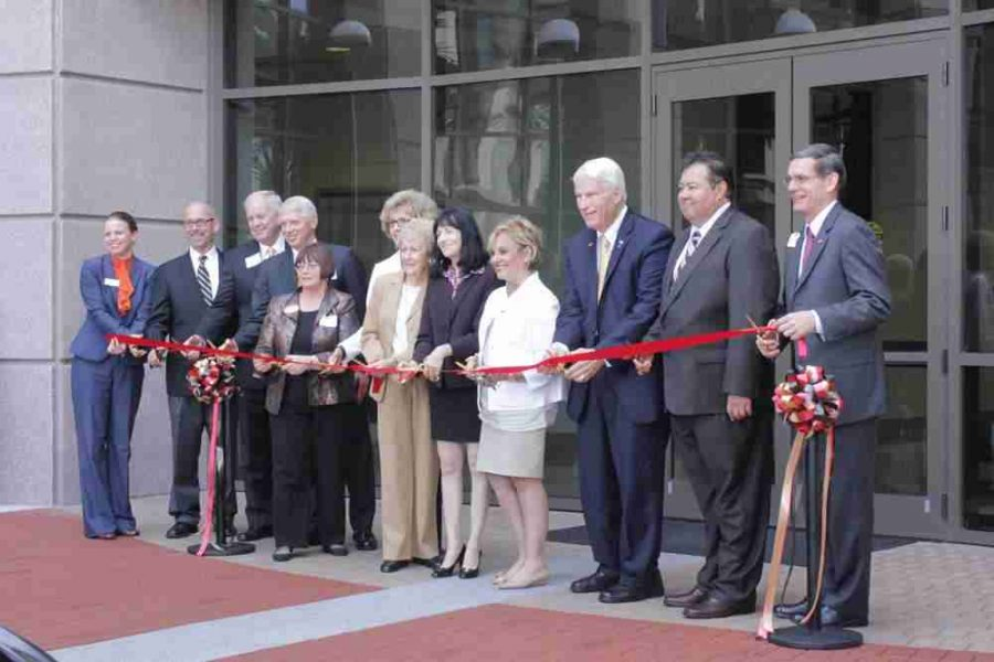 Valencia campus officials line up to cut the ribbon in front of Building 4. Osceola Campus President Kathleen Plinske, far left, was among those in attendance.