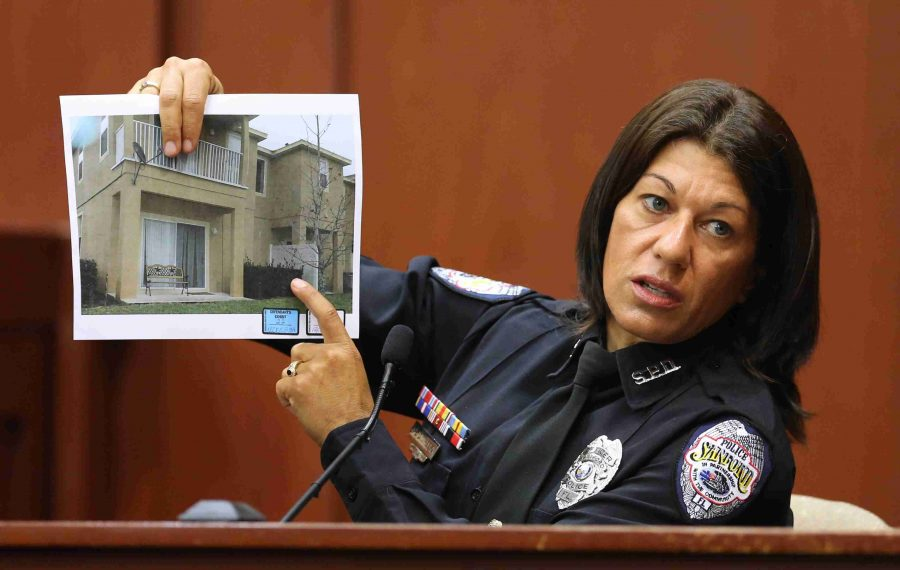Singleton holds up a copy of a photo of the complex where the Trayvon Martin shooting took place on Feb. 26, 2012