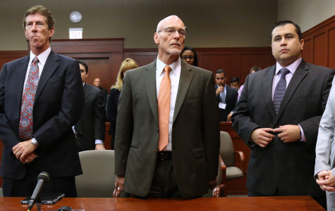 George Zimmerman (far right) and his legal council were  in the courtroom for less than five minutes this morning.