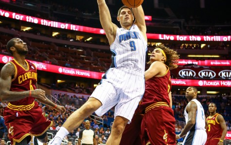 Orlando Magic Center Nikola Vucevic (9) dunks during first-quarter action of a preseason game against the Cleveland Cavaliers at Amway Center.