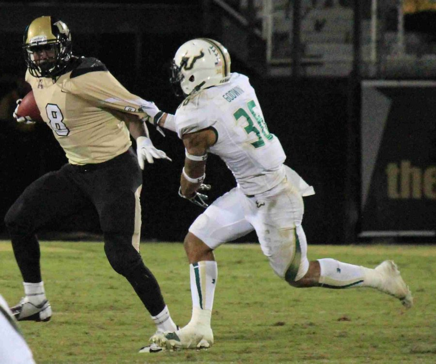 UCF+running+back+Storm+Johnson+%28left%29+rushed+for+64+yards+on+10+carries+in+the+Knights+win+over+USF.