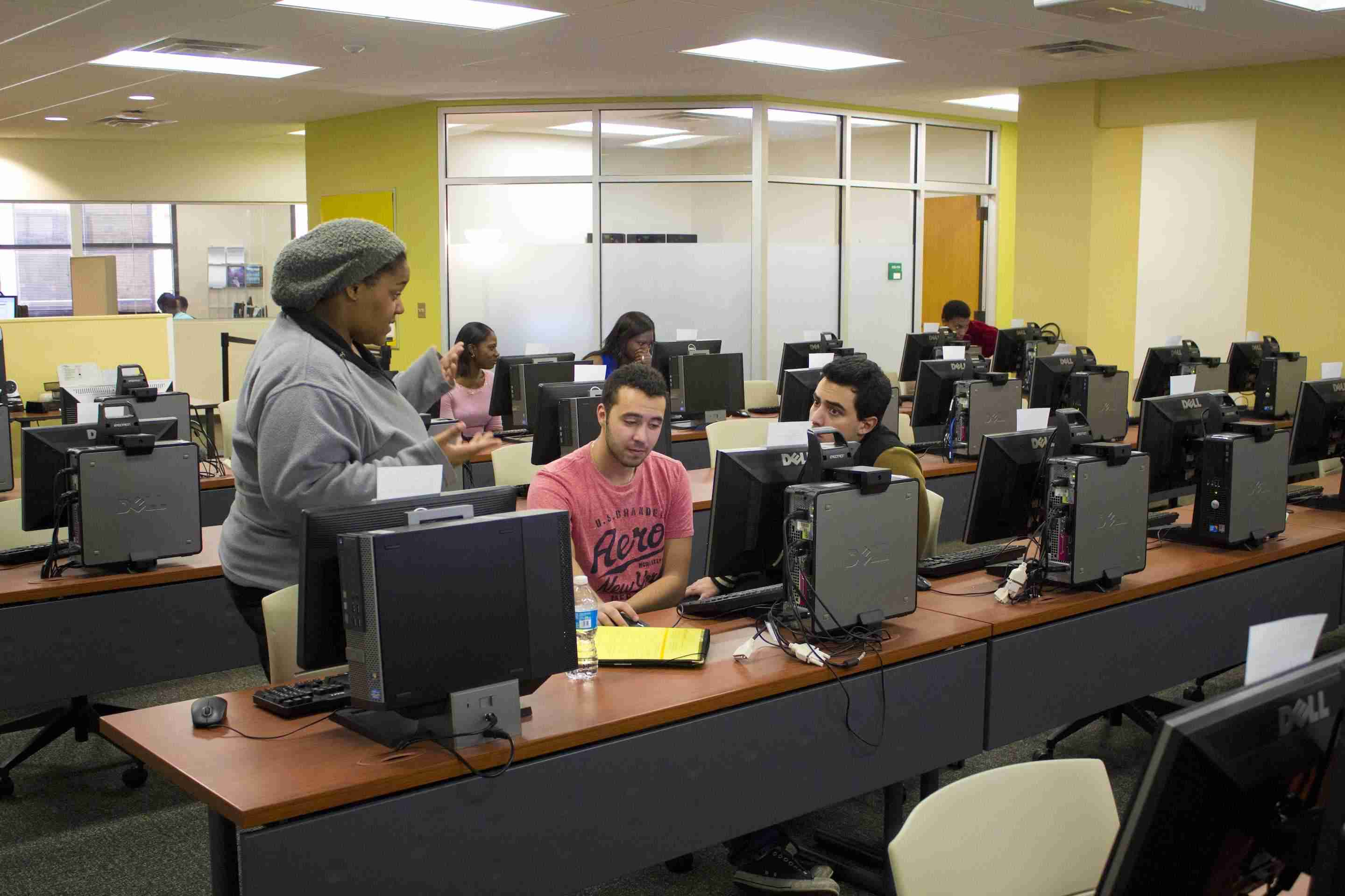 Kierah Johnson (left) helps students in the lab.