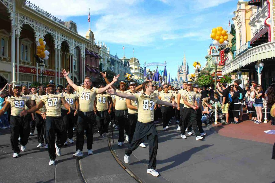 UCF+players+enjoy+the+moment+during+their+celebration+parade+at+the+Magic+Kingdom+on+Sunday.