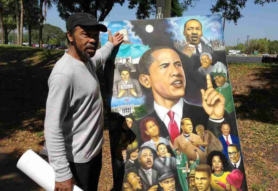 "Artist Terry K. Wilson selling his painting ""Forward We March,"" before President Obama's speech on West Campus"