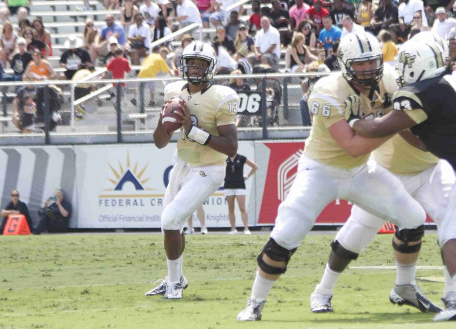 Justin Holman finished the spring game 18-31 passing for 165 yards.