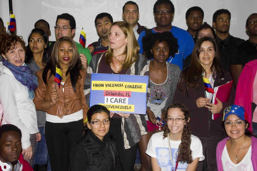 Students+gathered+in+on+West+campus+to+raise+awareness+on+the+situation+in+Venezuela.