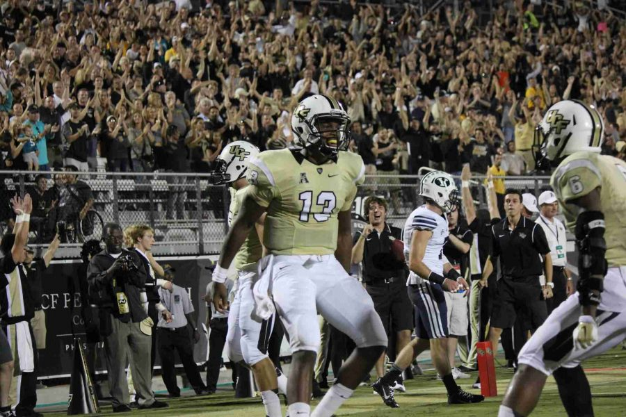 Justin+Holman+threw+for+a+career-high+326+yards+on+30+completions+in+UCF%27s+win+over+BYU.