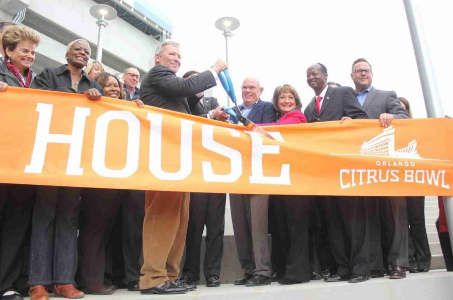 City+of+Orlando+mayor+Buddy+Dyer+cuts+the+ribbon+for+the+newly+renovated+Citrus+Bowl.