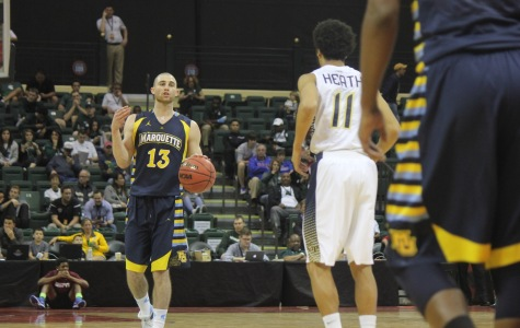Matt Carlino set a new Orlando Classic record with 38 points in Marquette's win over Georgia Tech.