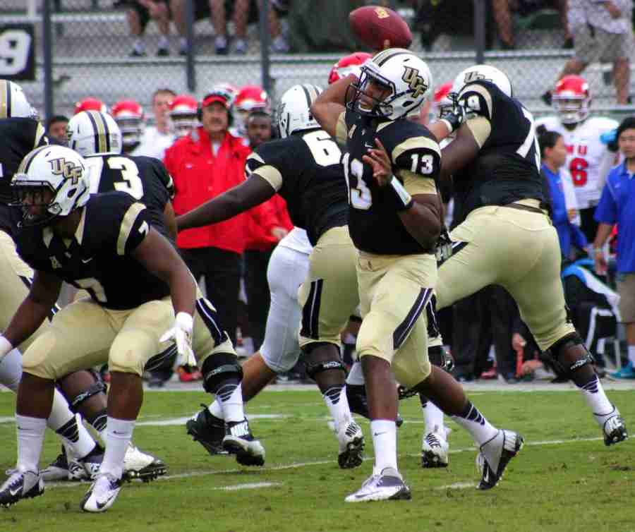Justin+Holman+has+thrown+for+2%2C387+yards+and+19+touchdowns+through+11+games+this+season+for+UCF.