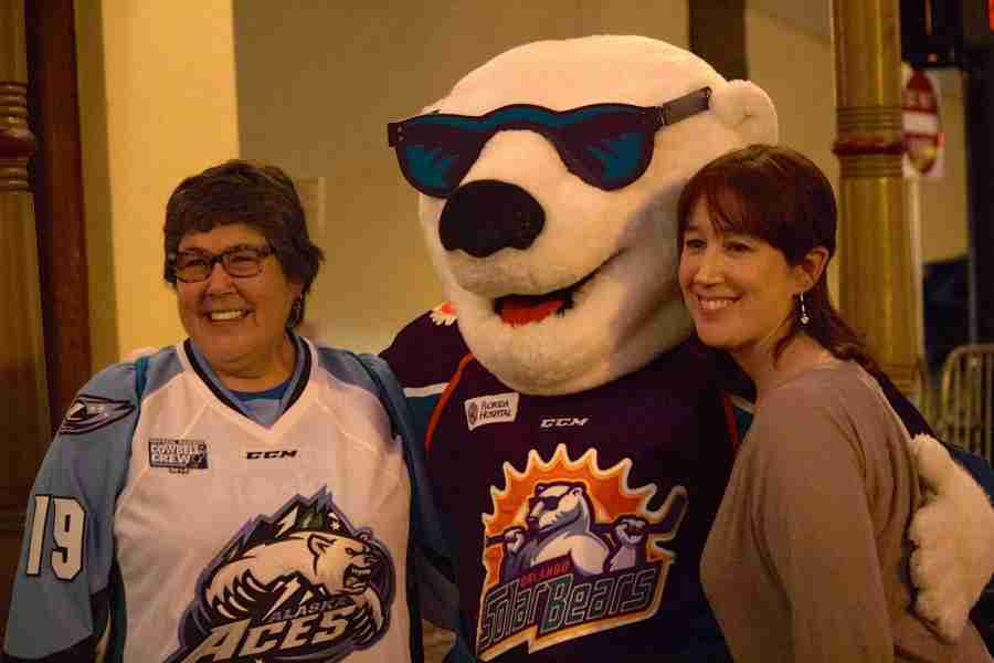 ECHL fans take pictures with Solar Bears' mascot Shades at ECHL All-Star Classic FanFest.