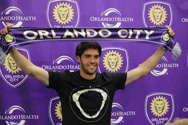 Orlando City SC midfielder Kaká with a club scarf.
