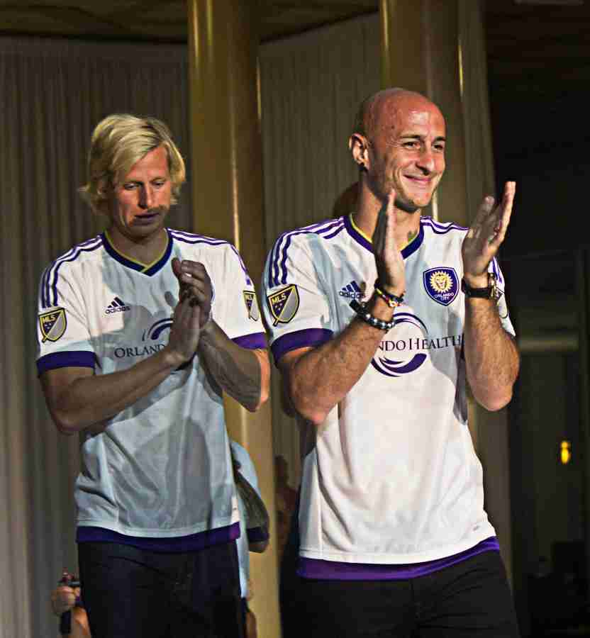 Orlando City Soccer players Brek Shea, left, and Aurélien Collin, right, unveils the new away jersey during the 4th Annual Soccer and the City fashion show at the Church Street Exchange on Tuesday, March 3, 2015. (Ty Wright / Valencia Voice)