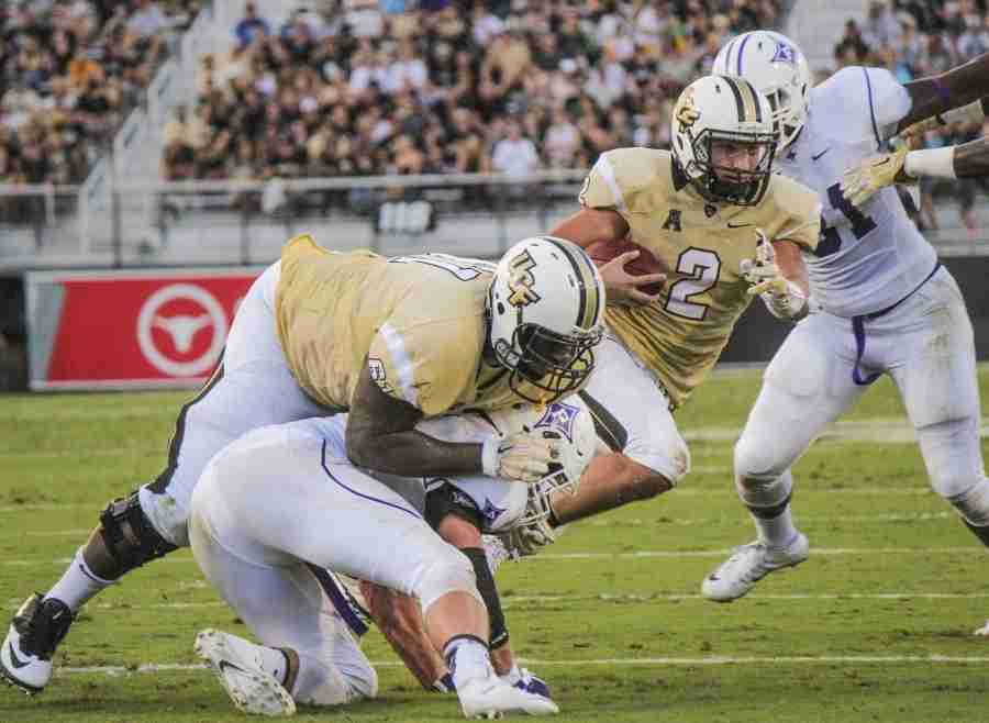 Nick+Patti+%28No.+2%29+led+UCF+in+rushing+with+58+yards+on+the+ground+against+Furman%2C+mostly+going+from+the+%22Wild+Knights%22+package.