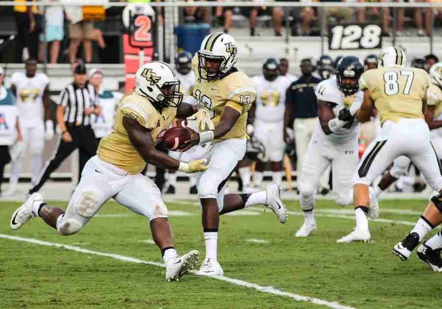 Dontravious+Wilson+%28left%29+suffered+an+injury+during+UCF%27s+season+opener%2C+leaving+Cedric+Thompson+and+William+Stanback+to+carry+the+load.