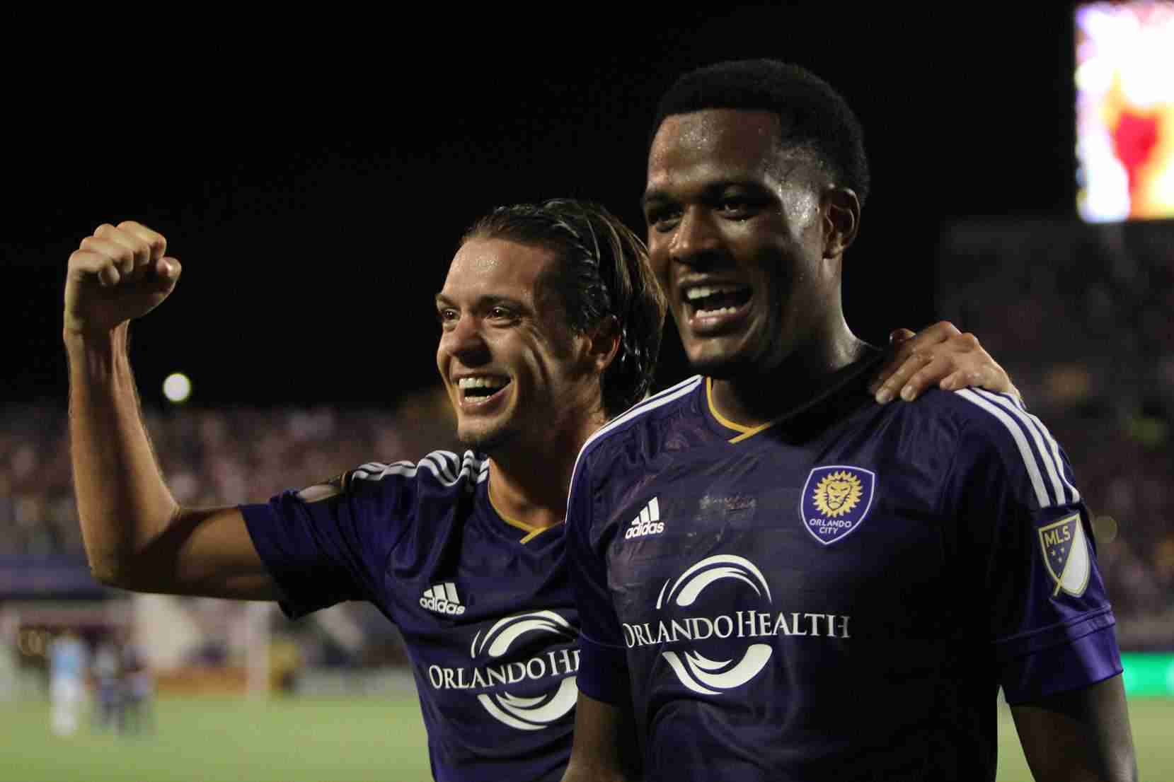Cyle Larin (right) scored two goals to help Orlando City SC defeat New York City FC 2-1 in their final regular season game at home.