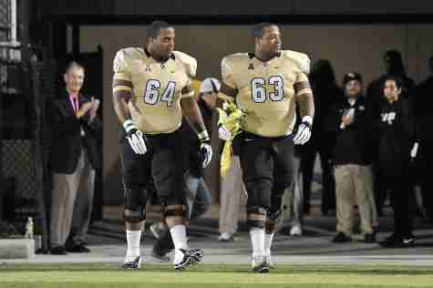 Justin (left) and Jordan McCray during their final home game for UCF in 2013.