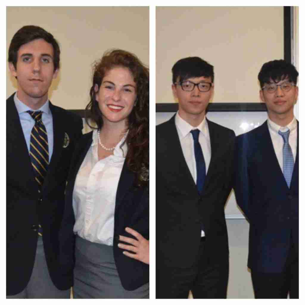 Student from Rollins College (left) and China (right) debated the Syrian conflict.