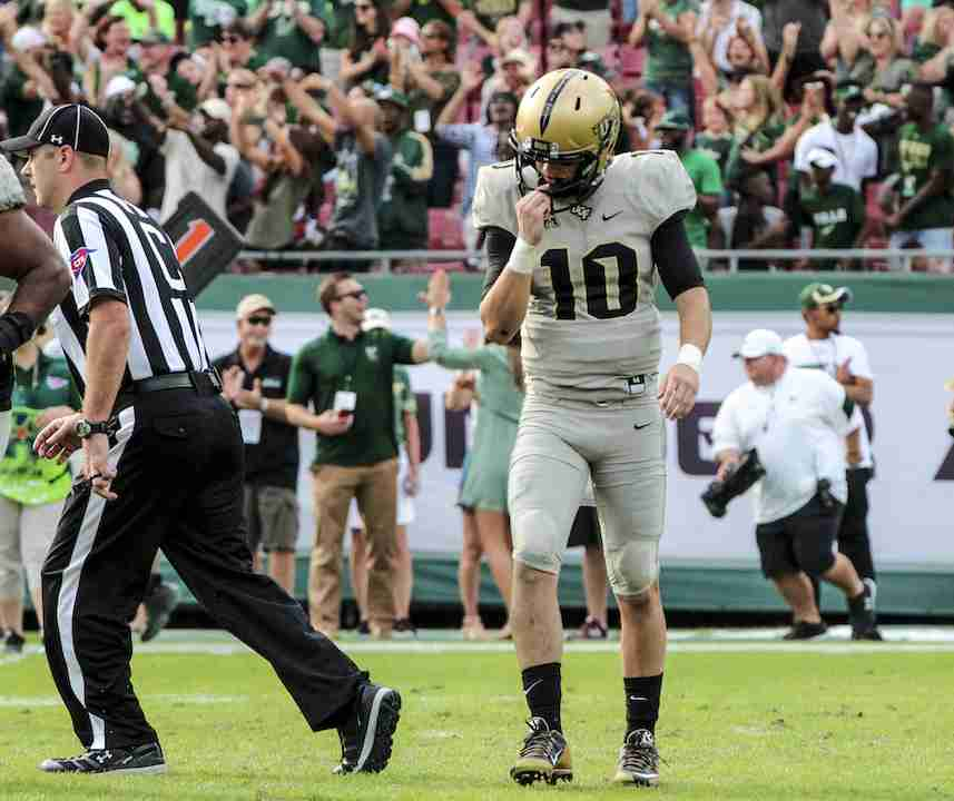 McKenzie Milton threw for 225 yards and had two interceptions in the Knights regular season ending loss to the USF Bulls.
