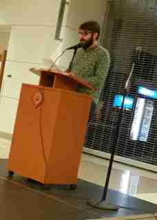 Ryan Tullis, coffeehouse MC, reciting a Sylvia Plath poem to warm up the audience and inspire others to come up and read.