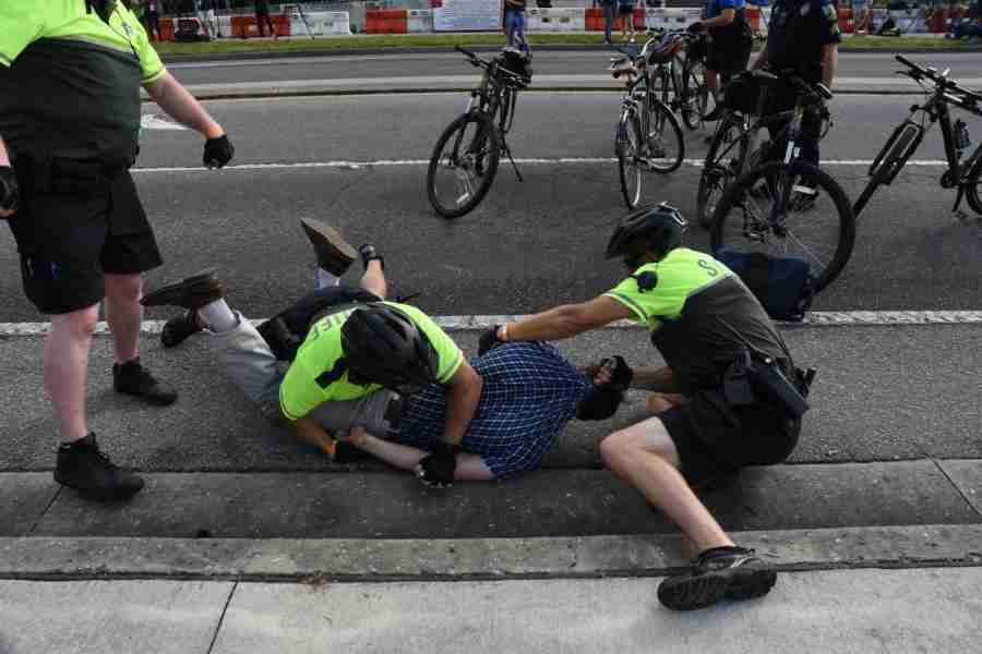 Police+arrest+man+riding+his+bike+through+the+protest+area+after+a+peaceful+discussion.