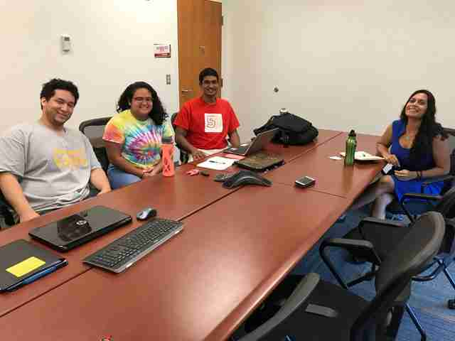 Shirsat sits with three of her four service learning students at their weekly mentor meeting. From left to right: Michael Shawn Cabrera, Mia Cabotaje, Ryan Singh, Resham Shirsat.