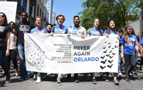 High school students lead a crowd of 25,000  through downtown Orlando to advocate gun regulations.