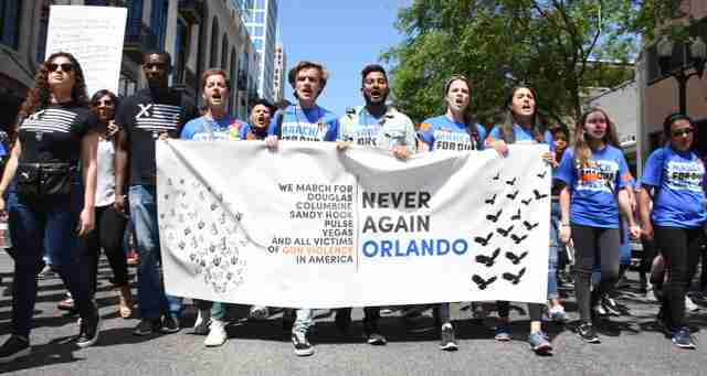 High+school+students+lead+a+crowd+of+25%2C000++through+downtown+Orlando+to+advocate+gun+regulations.