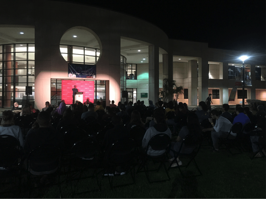 Attendees gather at Valencia's East Campus Mall area to enjoy the musical performance from Sid The Singer.