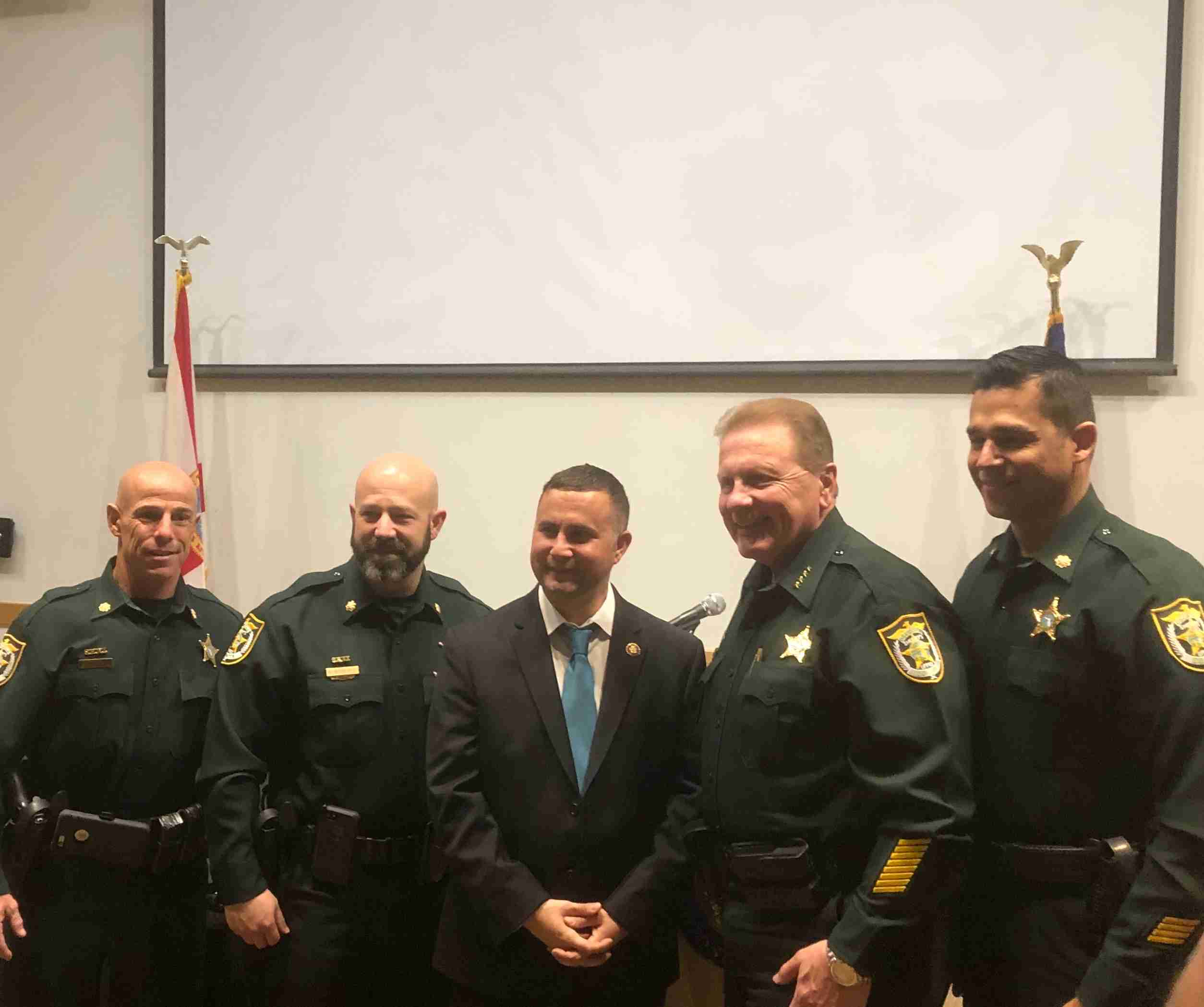 Congressman Darren Soto (center) poses with members of the Osceola County Sheriff's Office