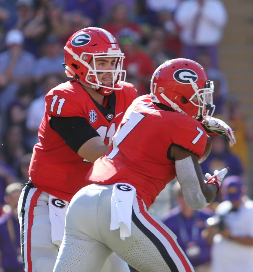 Georgia quarterback Jake Fromm (11) hands off the ball to Georgia Bulldogs running back D'Andre Swift (7), Georgia Bulldogs vs LSU Tigers, Football, Tiger Stadium, October 13, 2018, Baton Rouge, Louisiana,