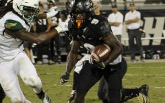 Adrian Killins Jr. (pictured) racked up 115 yards and a touchdown.