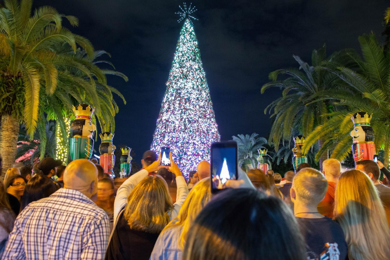 Attendees take photos of Lake Eola Christmas Tree