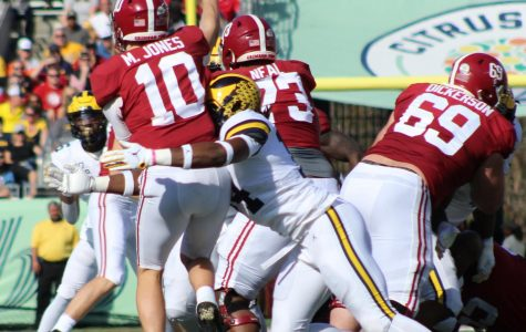 Alabama Quarterback Mac Jones (10) is able to get a pass away.