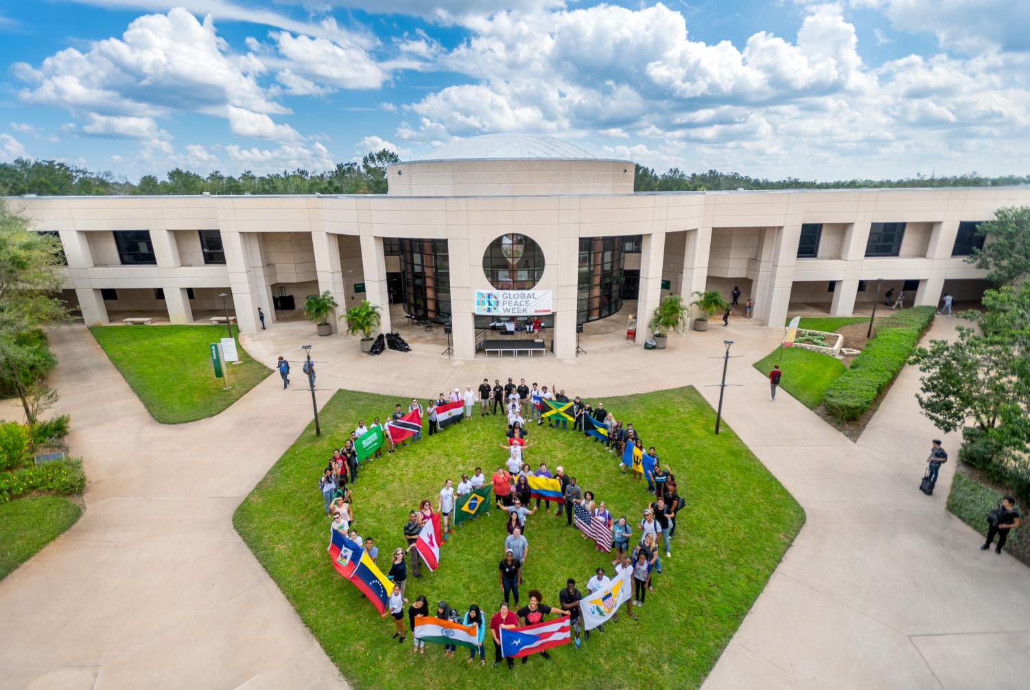 The Peace and Justice Institute organizes a human Peace Sign display on the East Campus of Valencia College on Peace Day, September 21, 2017, in Orlando, Fla.
