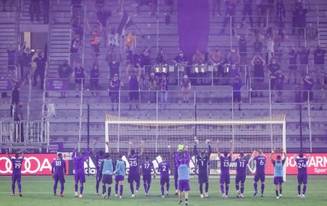 Orlando City players and fans exchanging waves pre game vs the Chicago Fire.