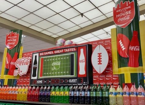 Coca- Cola display's their 2021 Super Bowl advertisement in grocery stores.