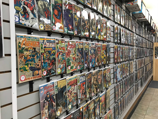 A Wall of  Marvel comic books are featured in a comic book store.