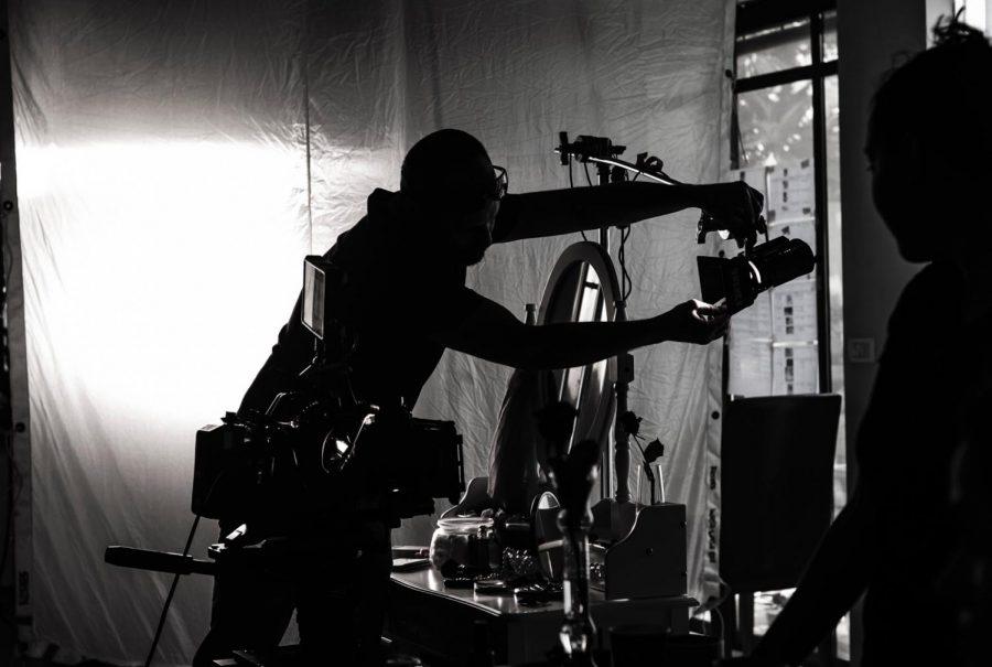 Man sets up movie production sight.