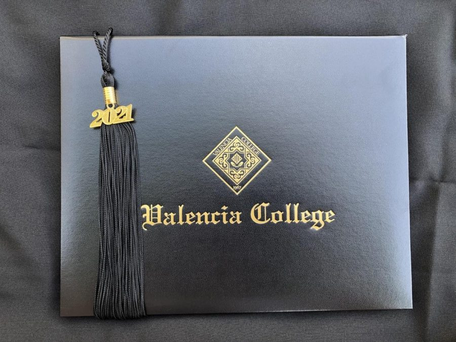Valencia College student diploma and tassel that has been mailed to students in a graduation box.